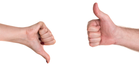 Thumbs up and down showing disagreement